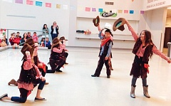 SUBMITTED PHOTO - Students from El Puente/Milwaukie Elementary School perform a special dance at last year's Noche Latina; students will perform this year as well.