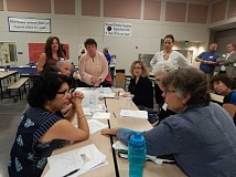 BARBARA SHERMAN - At the Sherwood School District's May 2 Bond Community Forum at Archer Glen Elementary, Laurel Ridge Middle School Prinicpal Penny Salm (standing at head of table) works with a group to come up with pros and cons for three proposed scenarios for a bond measure to improve district facilities.