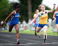 OUTLOOK PHOTO: JOSH KULLA - Fechi Nmereole of Gresham High School is edged out at the finish line in the 100 meter dash by Barlow junior Sara Turner, who won the event with a time of 12.17 seconds.