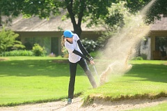 SPOKESMAN PHOTO: COREY BUCHANAN - Wilsonville girls golfer Lexie Huebert hits a shot out of of the bunker during the Wildcats' tournament at Charbonneau Golf Club.