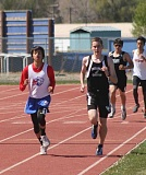 JEFF WILSON/THE PIONEER - Tyler Anderson, left, glides by another runner during the 3,000-meter run Saturday at the Madras Invitational.