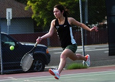 DAN BROOD - Tigard senior Delaney Shea hits a shot in No. 1 doubles play during Monday's match with Lakeridge.
