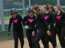 DAN BROOD - Tigard High School senior Abi Olson (left) is congratulated by her Tiger teammates after hitting a home run at Sherwood.