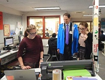 BARBARA SHERMAN - In the Sherwood High School engineering lab, Sen. Ron Wyden watches as juniors Emily Landgren (left) and Bridget McShane demonstrate how a piece of high-tech equipment works.