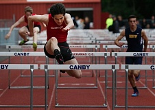 JON HOUSE - With just two days of practice in the event, Oregon City freshman Jake Follett ran the high hurdles in 16.07 at last weeks dual meet with Hood River. The time ranks Follett second among freshmen, on Oregon Citys list of all-time best high hurdlers.