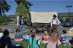 SUBMITTED PHOTO - Students at John Mcloughlin School in Oregon City check out a 170-year-old covered wagon from the Curtis Heritage Education Center.