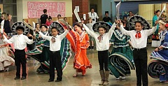 SPOKESMAN PHOTO: ANDREW KILSTROM - Boeckman Creek's Baile Folklorico dancers perform a number of excited onlookers.
