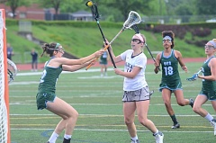 SPOKESMAN PHOTO: COREY BUCHANAN - MacKenzie Welberg aims her stick toward the goal against Oregon Episcopal School.