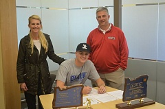 SPOKESMAN PHOTO: COREY BUCHANAN - Dylan Jordan signs his letter of intent at Wilsonville High School.