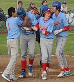 LON AUSTIN/THE PIONEER - Bryce Rehwinkel gets mobbed by teammates after hitting a home run Friday against Crook County.