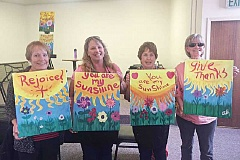 GABRIELLE BEEBE - Showing their uplifting paintings are Ann Neilson, left, Teri Drew, Bonnie Namenuk, and Annette Hausinger.