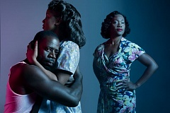 COURTESY: KATE SZROM - It's Demetrius Grosse as Stanley, Kristen Adele as Stella and Deidrie Henry as Blanche in Portland Center Stage's 'A Streetcar Named Desire.'