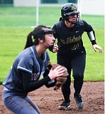 SPOTLIGHT PHOTO: JAKE MCNEAL - Lions catcher Taylor Leal will host a home run derby, open to the public, as part of her senior project at 2 p.m. on Saturday at St. Helens High School.