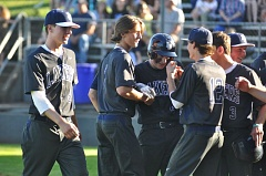MATTHEW SHERMAN - Lake Oswego's Cooper Cheetham is congratulated at home plate after hitting a home run in last week's victory over Lakeridge