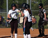 DAN BROOD - Tigard's Abi Olson (left) is congratulated by Hannah Spadafora and Caroline Riggs after scoring a fifth-inning run in Monday's game. The Tigers got a 4-3 win over Sherwood.