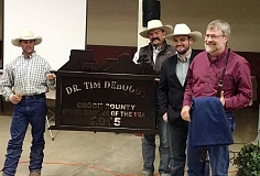 PHOTO CONTRIBUTED BY GRACE DEBOODT - Tim Deboodt, far right, poses for a photo after being named Crook County Stock Grower of the Year for 2015.