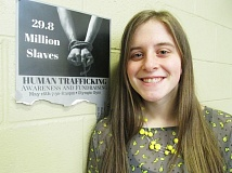 OUTLOOK PHOTO: TERESA CARSON - Barlow freshman and speech champion Katie Card displays a poster for her May 16 human trafficking awareness event.