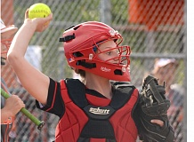THE OUTLOOK: DAVID BALL - Corbett catcher Lindsey Flegel pops up to make a throw.