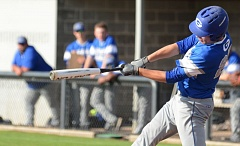 THE OUTLOOK: DAVID BALL - Greshams Austen Carpenter swings through during an at-bat in the fourth inning.