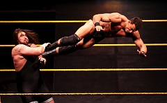 TRIBUNE PHOTO: DAVID BLAIR - Tucker Knight (left), from Hubbard, Oregon, battles Tino Sabbatelli (aka former Oregon State football player Sabby Piscitelli). Knight, whose real name is Levi Cooper, prevailed in the duel of local favorites Saturday night in a WWE NXT show at Moda Center.