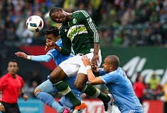 TRIBUNE PHOTO: JONATHAN HOUSE - Fanendo Adi of the Portland Timbers heads the ball in between two New York City FC players during Sunday's 2-1 home loss at Providence Park.