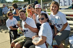 REVIEW PHOTO: VERN UYETAKE - Parents, students and community members proudly wear their One Lake One Love T-shirts at a girls softball game on May 9 in a show of support for student athletes from both Lakeridge and Lake Oswego high schools.