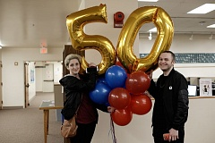 CCC students Rebecca Mulanax and Jordan Kraig help the college launch its birthday festivities with balloons on the Oregon City campus at the start of spring term.