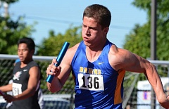 THE OUTLOOK: DAVID BALL - Barlows Wyatt Radke heads into the final turn during the Bruins win in the 400-meter relay.