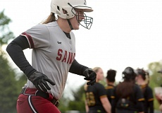 SANDY POST: DAVID BALL - Sandys Hannah Holliday returns home after hitting a two-run shot that gave the Pioneers a brief 2-1 lead in last weeks loss to Rex Putnam.
