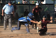 CONTRIBUTED PHOTO: MIKE WEBER - Corbetts Lindsey Flegel is tagged out at the plate during the sixth inning of last weeks 6-5 win over Crook County.