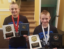 SUBMITTED - Oregon City brothers Austin (left) and Carter Nekvapil proudly display their hardware from the recent Oregon Kid Wrestling Greco Roman and Freestyle State Championships.