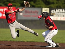 JAIME VALDEZ - Oregon City junior infielder Tyler Hartenstein attempts a double play in last Fridays game with Clackamas, after getting the force out on Greg Mehlhaff at second.