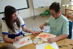 SPOKESMAN PHOTO: VERN UYETAKE - Art Specialist Kyna  Brockett works with Miles Pollack on an art project.