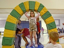 SPOKESMAN PHOTO: VERN UYETAKE - Boeckman Creek third-grader Lauren Carroll  gets ready to test the ability of an arch to support itself.