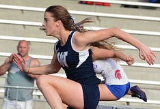 SUBMITTED PHOTO: DAVID BALL - Wilsonville's Kristen Burke set a school record in the 100-hurdles at the district meet.