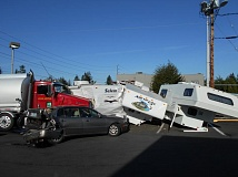 CONTRIBUTED PHOTO - A multi-vehicle crash slowed traffic on Proctor Boulevard on Friday, after the 44-year-old driver of a commercial fuel truck and trailer owned by Space Age Fuel suffered a coughing fit and blacked out behind the wheel. No one was injured in the crash, which damaged three RVs, two cars and a tree.