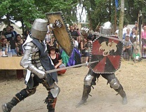 CONTRIBUTED PHOTO - Sandy-area residents Daniel Florence and Doug Leaf do battle during a Gloucester Duchy event. The duchy is part of the Adria Empire, an organization for people who enjoy European medieval history and lifestyle activities, and is holding its first Banner War Northwest May 27-30 in Sandy.