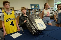 REVIEW PHOTO: VERN UYETAKE - Jack Kelley (from left), Wyatt Stuart, Lily Seiber and Ellie Nicoll get ready to open the time capsule at Lake Oswego Junior High.