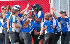 THE OUTLOOK: JOSH KULLA - Teammates greet Dosjanee McCloyn at the plate after her solo home run during a game-breaking fifth inning Tuesday against Lincoln.