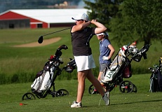 DAN BROOD - Tigard High School sophomore Victoria Gailey watches her drive on hole No. 18 during play Tuesday at the Class 6A state tournament.