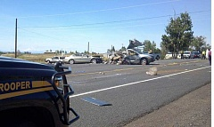 SUBMITTED PHOTO - Four people died from injuries in a three-vehicle accident May 17, on U.S. Highway 97, near Bear Drive. The Honda Accord and Pontiac van are visible in this photo, which shows the scene.