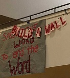 COURTESY PHOTO - A banner with the words 'Build A Wall' appeared briefly on the cafeterial wall at Forest Grove High School Wednesday.