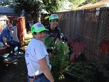 SUBMITTED PHOTO -  Mother & Daughter Team, Laurie & Katy Roach serve with a smile during annual Neighbor 2 Neighbor Day.