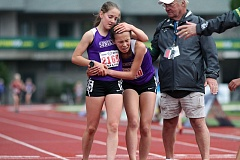 TRIBUNE PHOTO: AMANDA MILES - Sunset's Ember Stratton (left) holds teammate Audrey Huelskamp at the end of the girls 3,000 meters at the Class 6A state track meet at Hayward Field in Eugene on Friday. Stratton, a freshman, won the event while Huelskamp finished seventh.