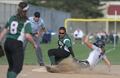 PAMPLIN MEDIA GROUP: AMANDA MILES - Wilson High's Saioa Lostra tries to make a play at third base on Glencoe's Ashlynn Bailey during a first-round state playoff game Monday.