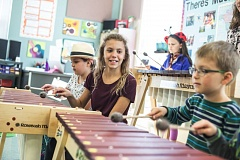 TIMES PHOTO: JONATHAN HOUSE - Tabi Searle enjoys playing the marimba with her schoolmates at Tualatin Elementary School.
