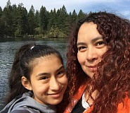 CONTRIBUTED PHOTO: PAULINA MENCHACA - City councilor Paulina Menchaca stands with her daughter Andrea at the Clackamas River, one of their favorite places to spend time.