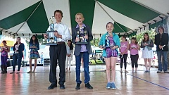 COURTESY VALERIE DAWN - Three children receive trophies for their performances at the 2015 Multnomah County Fair talent show.