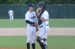 SPOKESMAN PHOTO: COREY BUCHANAN - Wilsonville catcher Dominic Enbody talks to relief pitcher Tucker Munson on the mound during the seventh inning of the Wildcats' win over Pendleton.