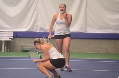SPOKESMAN PHOTO: COREY BUCHANAN - Wilsonville's No. 1 doubles team of Madi Wardle (back) and Hanna Heilig celebrate after winning their state quarterfinals match.